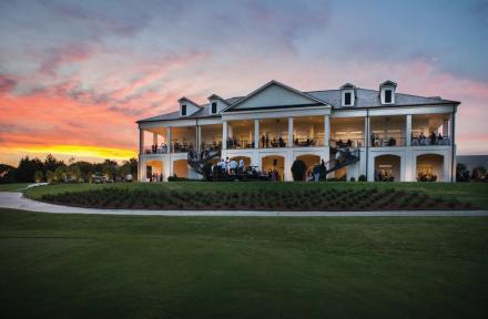 Clubhouse with people inside during sunset